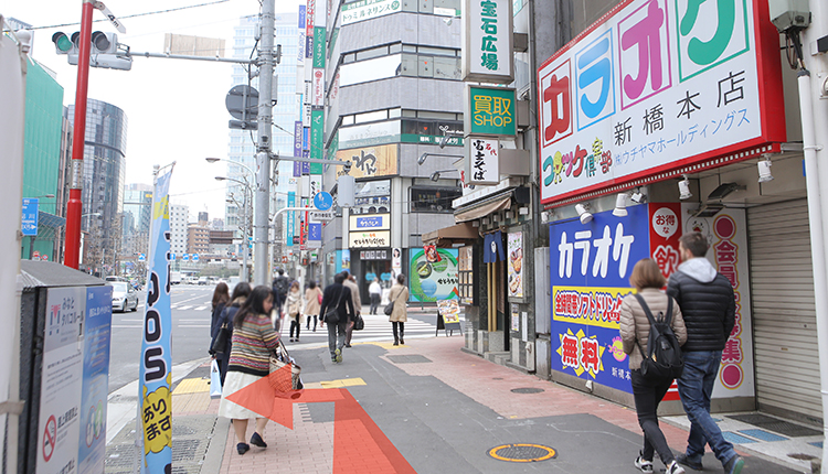 Walk about 50m you will see a karaoke shop on the right. And cross the intersection in front of you to the left.